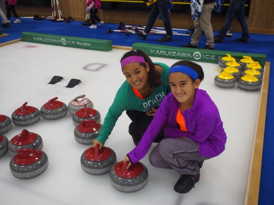 My sister and i with the 20kg curling stones