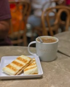A local Singaporean breakfast, Kaya Toast and Kopi (local coffee) from Toast Box at Ion Orchard.