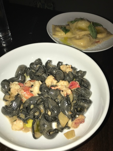 Squid ink lumache on the bottom and the stracciatelle ravioli on the top