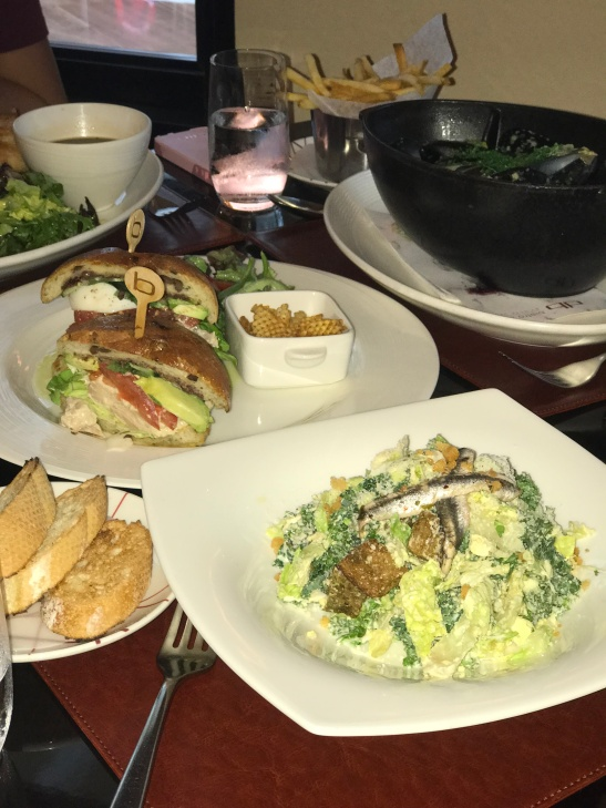 Kale caesar salad, cured tuna sandwich, and moules frites.