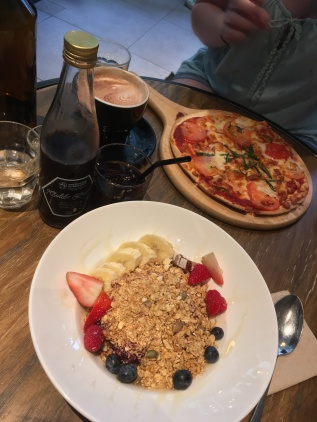 Acai bowl, flatbread margherita pizza and cold brew coffee.