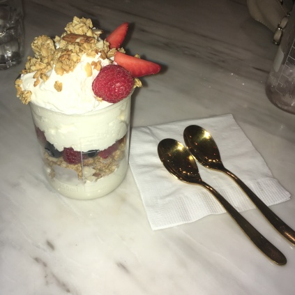 Yoghurt parfait with granola and fresh berries.