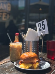 Mid-week pick me up brunch from Highland Cafe in Eagle Rock. An iced coffee and an egg, cheese and bacon sandwich.