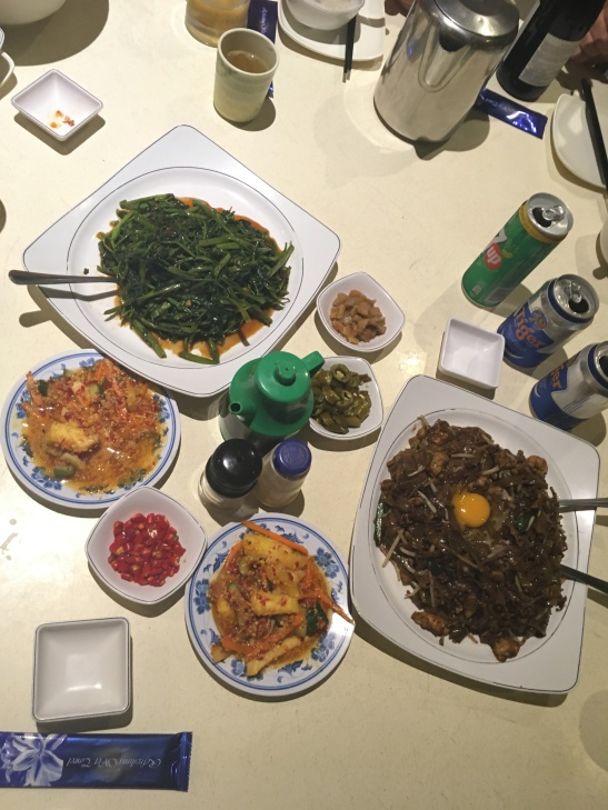 Stir-fried kway teow, sambal kang kong and pickles.
