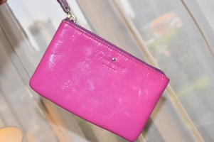 A purple wristlet, perfect to grab and go