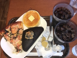 Stopped to grab breakfast before a trip on the shinkansen and this is what happened. Cheese and mentaiko 'pizza', squid ink curry pan (bread), and a Japanese style pancake with butter and maple syrup. And of course, COFFEE. From Kobeya Kitchen at Nagano Station.