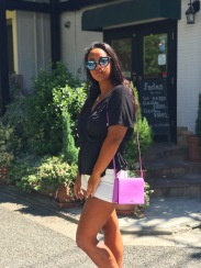 H&M black wrap top with H&M white jean shorts and a purple Kate Spade cross-body.