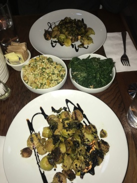 I dare anyone who says they hate brussels sprouts to eat this and not like it, it's impossible. Amazing grilled, crispy sprouts with a balsamic reduction with a side of kale salad and quinoa salad // Four Cafe, Eagle Rock