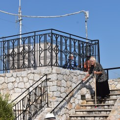 The cutest Yia-Yia (Grandma) working at the temple at Lykavittos.
