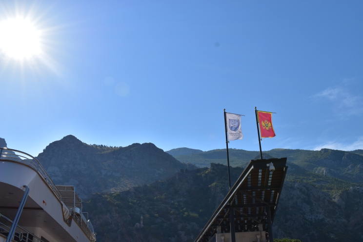 The Montenegrin flag blowing in the wind.