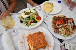 Moussaka, Greek salad and a gyros platter.