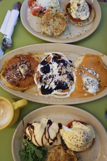 Brunch at Snooze: blueberry lemon, maple pecan and sweet potato pancakes, and two types of Eggs Benedict.