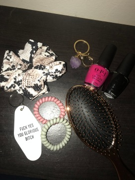Snakeskin scrunchie, spiral hairties, the best key chain to exist, amethyst keychain, rose gold wet brush and OPI nail polish in a hot pink and black.